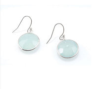 "Chalcedony Round Earrings by Philippa Roberts Jewelry based in Oakland, Ca. Multifaceted chalcedony stones with a sterling silver bezel and sterling silver french wires. Hangs 5/8"". Chalcedony is opaque and can be more blue or green depending on the stone. Each piece is unique in color making no set alike."