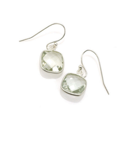 "Green Amethyst Square Silver Earrings by Philippa Roberts Jewelry based in Oakland, Ca. Multifaceted green amethyst stones with a sterling silver bezel and sterling silver french wires. Hangs 7/8"". Green Amethyst is pale green in color and can almost appear to be clear. Each piece is unique in color making no set alike."