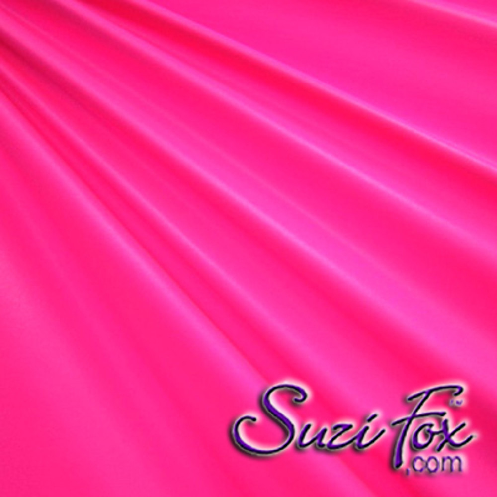 "Hot Pink Wet Look Lycra Spandex (Cire') Fabric.  85% Nylon. 15% Lycra. (per yard price if you want to buy extra is $25 per yard) This is a four way stretch fabric. Wet look lycra fabrics have undergone a heat treatment to give them a ""Cire'"" medium shine finish. Wet look lycra is a very stretchy fabric, it hugs the body but is extremely comfortable, and dries quickly. Available in black, white, red, turquoise, navy blue, royal blue, hot pink, lime green, green, yellow, steel gray, neon orange Wet Look.  Hand wash inside out in cold water, line dry. Iron inside out on low heat. Do not bleach."