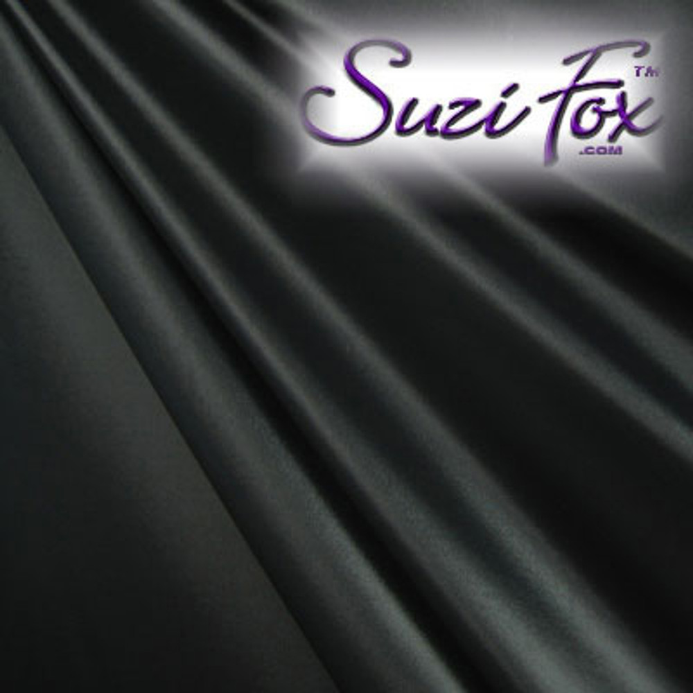 "Black Wet Look Lycra Spandex (Cire') Fabric.  85% Nylon. 15% Lycra. (per yard price if you want to buy extra is $25 per yard) This is a four way stretch fabric. Wet look lycra fabrics have undergone a heat treatment to give them a ""Cire'"" medium shine finish. Wet look lycra is a very stretchy fabric, it hugs the body but is extremely comfortable, and dries quickly. Available in black, white, red, turquoise, navy blue, royal blue, hot pink, lime green, green, yellow, steel gray, neon orange Wet Look.  Hand wash inside out in cold water, line dry. Iron inside out on low heat. Do not bleach."