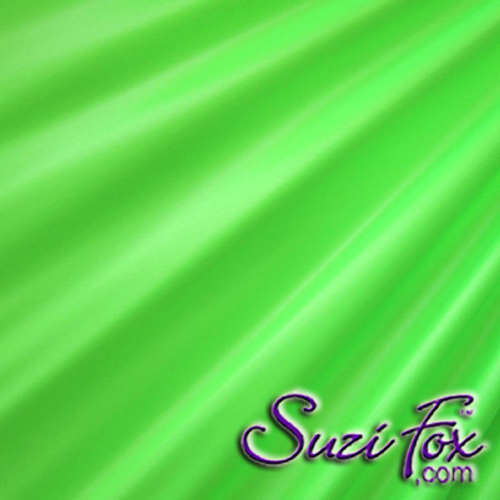 "Lime Green Wet Look Lycra Spandex (Cire') Fabric.  85% Nylon. 15% Lycra. (per yard price if you want to buy extra is $25 per yard) This is a four way stretch fabric. Wet look lycra fabrics have undergone a heat treatment to give them a ""Cire'"" medium shine finish. Wet look lycra is a very stretchy fabric, it hugs the body but is extremely comfortable, and dries quickly. Available in black, white, red, turquoise, navy blue, royal blue, hot pink, lime green, green, yellow, steel gray, neon orange Wet Look.  Hand wash inside out in cold water, line dry. Iron inside out on low heat. Do not bleach."