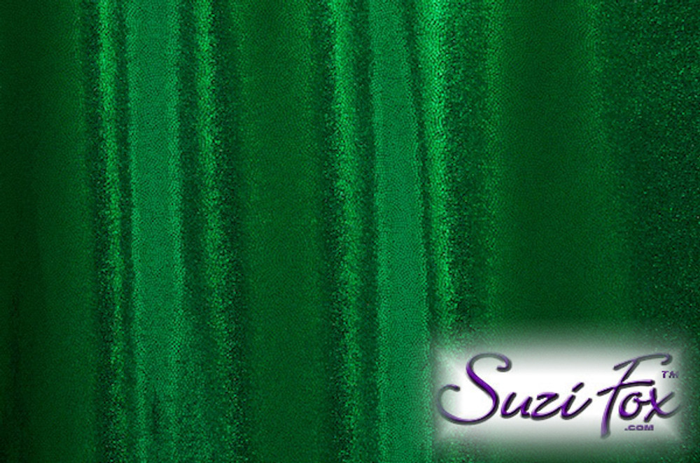 Green Metallic Mystique Fabric. (per yard price if you want to buy extra is $25 per yard) 80% Nylon, 20% Spandex. Available in black, red, turquoise, green, purple, royal blue, hot pink/fuchsia, baby pink, baby blue, silver, copper, gold Metallic Mystique spandex. This is a 4-way stretch fabric with tiny metallic foil dots bonded to the spandex. Light, thin, airy, very comfortable! Glitters in the light!  Metallic will rub off if rubbed excessively. Hand wash inside out in cold water, line dry. Iron inside out on low heat. Do not bleach.