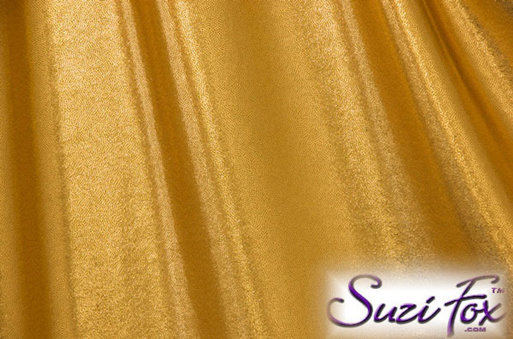 Gold Metallic Mystique Fabric. (per yard price if you want to buy extra is $25 per yard) 80% Nylon, 20% Spandex. Available in black, red, turquoise, green, purple, royal blue, hot pink/fuchsia, baby pink, baby blue, silver, copper, gold Metallic Mystique spandex. This is a 4-way stretch fabric with tiny metallic foil dots bonded to the spandex. Light, thin, airy, very comfortable! Glitters in the light!  Metallic will rub off if rubbed excessively. Hand wash inside out in cold water, line dry. Iron inside out on low heat. Do not bleach.
