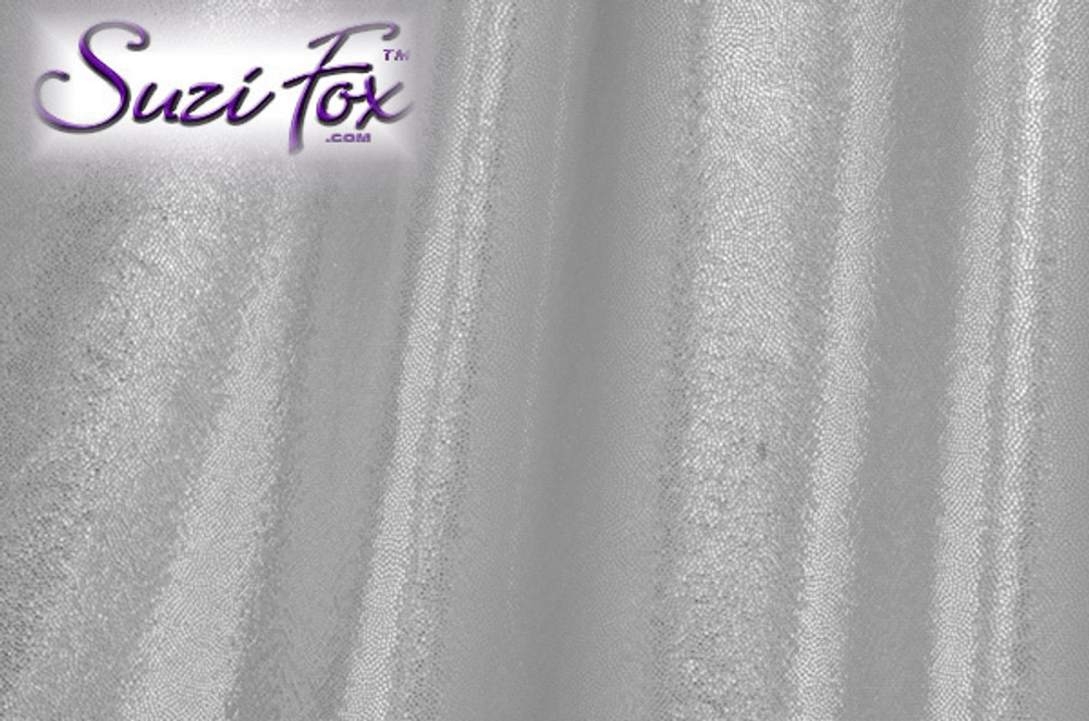 Silver Metallic Mystique Fabric. (per yard price if you want to buy extra is $25 per yard) 80% Nylon, 20% Spandex. Available in black, red, turquoise, green, purple, royal blue, hot pink/fuchsia, baby pink, baby blue, silver, copper, gold Metallic Mystique spandex. This is a 4-way stretch fabric with tiny metallic foil dots bonded to the spandex. Light, thin, airy, very comfortable! Glitters in the light!  Metallic will rub off if rubbed excessively. Hand wash inside out in cold water, line dry. Iron inside out on low heat. Do not bleach.