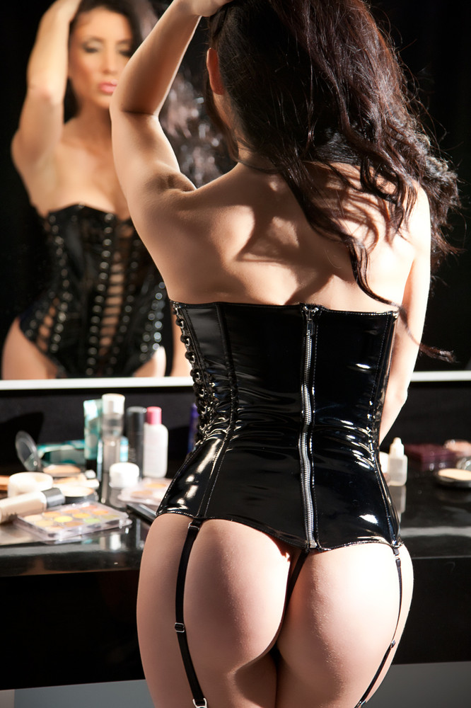 Allure Leather Lace-Up Vinyl Corset.  This vinyl corset has seductive lace-up detailing on the front and sides. Boning and the back zipper opening make it fit like a second skin.  G-STRING INCLUDED