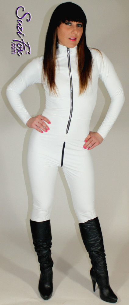 """Custom Catsuit by Suzi Fox shown in Matte White (no shine) Vinyl/PVC coated Nylon Spandex. Shown with optional 1-slider crotch zipper. You can order this Catsuit in almost any fabric on this site.  • Available in black matte (no shine), white matte (no shine), and gloss black, red, white, light pink, neon pink, fuchsia, purple, royal blue, navy blue, turquoise, stretch vinyl coated spandex. • Your choice of front or back zipper (front zipper shown). • Optional 1 or 2-slider crotch zipper, and """"Selene"""" from Underworld TS zipper, or aluminum circular slider zipper like Catwoman comic characters. • Optional wrist zippers • Optional ankle zippers • Optional finger loops • Optional rear patch pockets • Made in the U.S.A."""