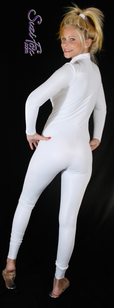"""Custom Catsuit by Suzi Fox shown in White Wet Look Lycra Spandex.  You can order this Catsuit in almost any fabric on this site.  • Available in black, red, white, turquoise, navy blue, hot pink, lime green, green, yellow, royal blue, steel gray, neon orange. This is a 4-way stretch fabric with a medium shine. • Your choice of front or back zipper (front zipper shown). • Optional 1 or 2-slider crotch zipper, and """"Selene"""" from Underworld TS Brass zipper, or aluminum circular slider zipper like Catwoman comic characters. • Optional wrist zippers • Optional ankle zippers • Optional finger loops • Optional rear patch pockets • Made in the U.S.A."""