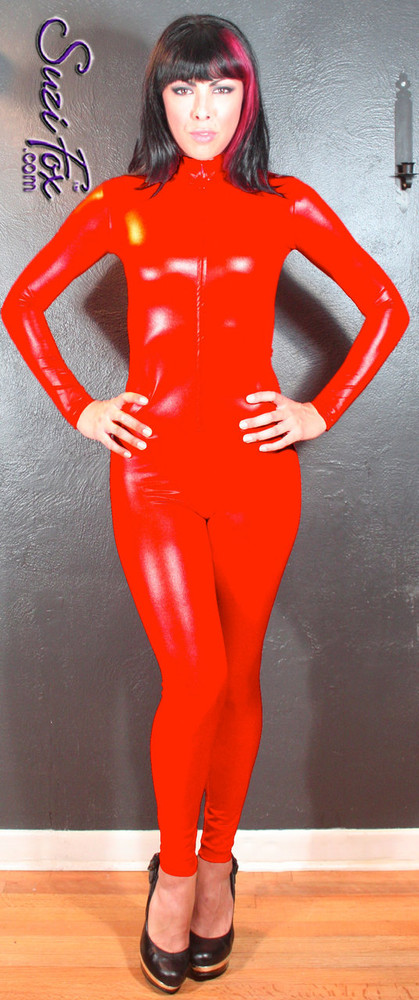 "Custom Catsuit by Suzi Fox shown in Red Wet Look Lycra Spandex.  You can order this Catsuit in almost any fabric on this site.  • Available in black, red, white, turquoise, navy blue, hot pink, lime green, green, yellow, royal blue, steel gray, neon orange. This is a 4-way stretch fabric with a medium shine. • Your choice of front or back zipper (front zipper shown). • Optional 1 or 2-slider crotch zipper, and ""Selene"" from Underworld TS Brass zipper, or aluminum circular slider zipper like Catwoman comic characters. • Optional wrist zippers • Optional ankle zippers • Optional finger loops • Optional rear patch pockets • Made in the U.S.A."