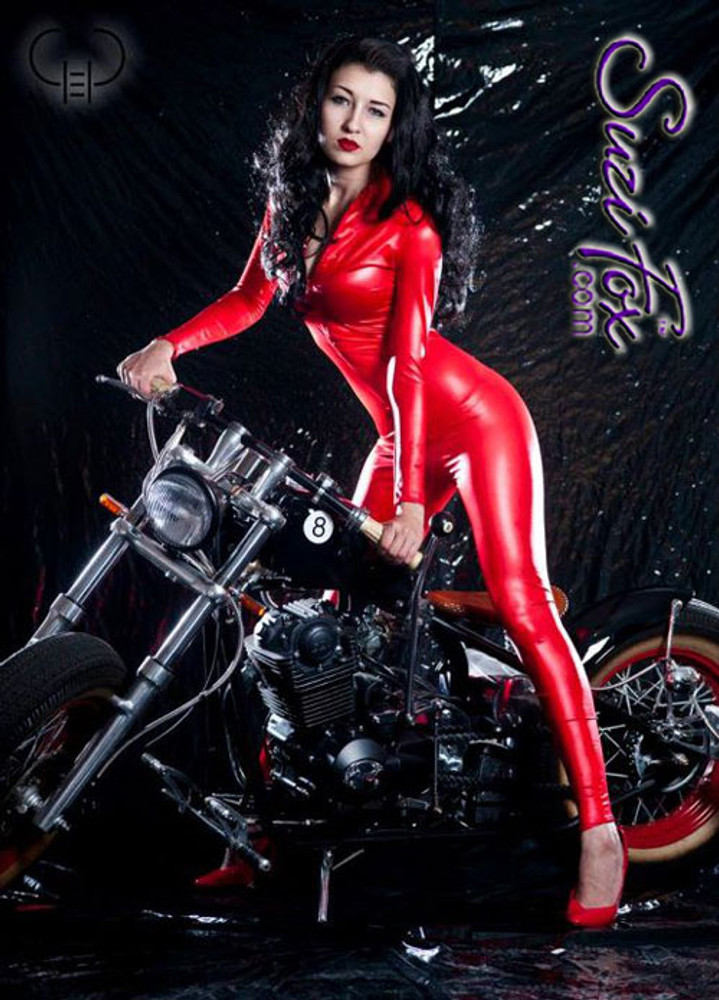 "Custom Catsuit by Suzi Fox shown in Red Wet Look Lycra Spandex.  You can order this Catsuit in almost any fabric on this site.  • Available in black, red, white, turquoise, navy blue, hot pink, lime green, green, yellow, royal blue, steel gray, neon orange. This is a 4-way stretch fabric with a medium shine. • Your choice of front or back zipper (front zipper shown). • Optional 1 or 2-slider crotch zipper, and ""Selene"" from Underworld TS Brass zipper, or aluminum circular slider zipper like Catwoman comic characters. • Optional wrist zippers • Optional ankle zippers • Optional finger loops • Optional rear patch pockets • Made in the U.S.A. Photo by Gregory Mohn"