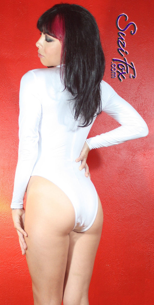 Custom Leotard by Suzi Fox shown in White Wet Look Lycra Spandex.  You can order this Leotard in almost any fabric on this site.  • Available in black, red, white, turquoise, navy blue, hot pink, lime green, green, yellow, royal blue, steel gray, neon orange. This is a 4-way stretch fabric with a medium shine. Shown with French Legs (Rio rear). • Optional Bust Cutout • Your choice of rears - French legs (Rio), Cheeky, Full, or Thong. • Made in the U.S.A.