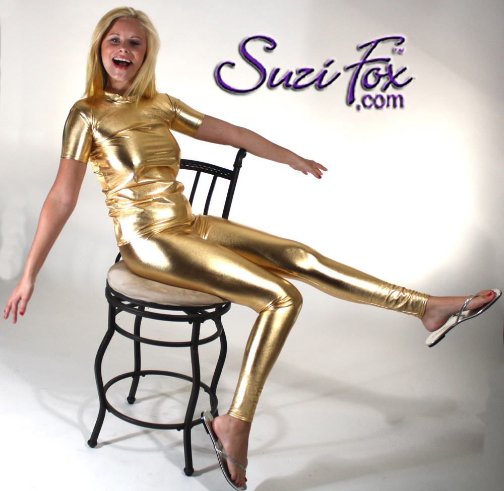 Womens Leggings shown in Gold Metallic Foil Spandex, custom made by Suzi Fox. You can order this in almost any fabric on this site.  • Custom made to your measurements! • Available in gold, silver, copper, royal blue, purple, turquoise, red, green, fuchsia, gun metal, black faux leather/rubber coated spandex. This is a 4-way stretch fabric with a brilliant shine. • 1 inch elastic at the waist. • Optional 1 or 2-slider crotch zipper. • Optional ankle zippers • Optional rear patch pockets • Optional belt loops • Made in the U.S.A.