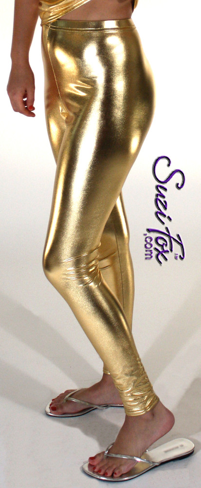 Womens Leggings shown in Gold Metallic Foil Spandex, custom made by Suzi Fox. Waist High rise shown. You can order this in almost any fabric on this site.  • Custom made to your measurements! • Available in gold, silver, copper, royal blue, purple, turquoise, red, green, fuchsia, gun metal, black faux leather/rubber coated spandex. This is a 4-way stretch fabric with a brilliant shine. • 1 inch elastic at the waist. • Optional 1 or 2-slider crotch zipper. • Optional ankle zippers • Optional rear patch pockets • Optional belt loops • Made in the U.S.A.
