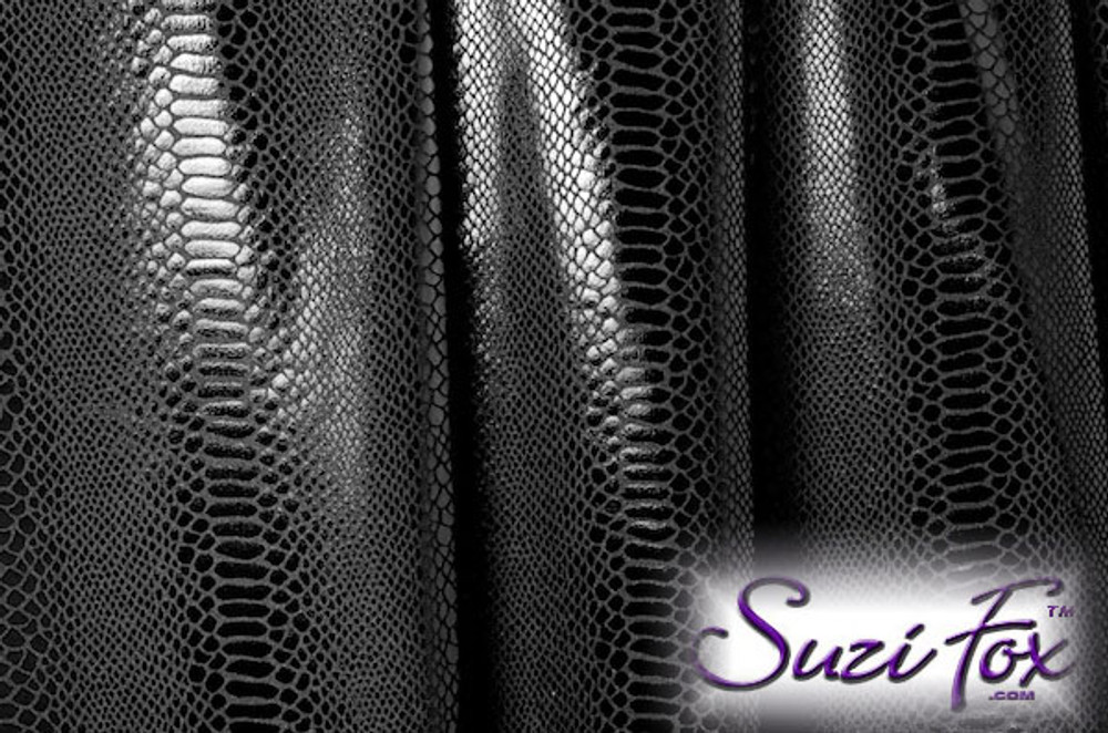 Black Metallic Foil Snake Print coated Spandex. 4-way stretch. 80% Nylon, 20% Spandex.  Metallic will rub off if rubbed excessively. Foil will separate from spandex backing if worn too tight. Hand wash inside out in cold water, line dry. Iron inside out on low heat. Do not bleach.