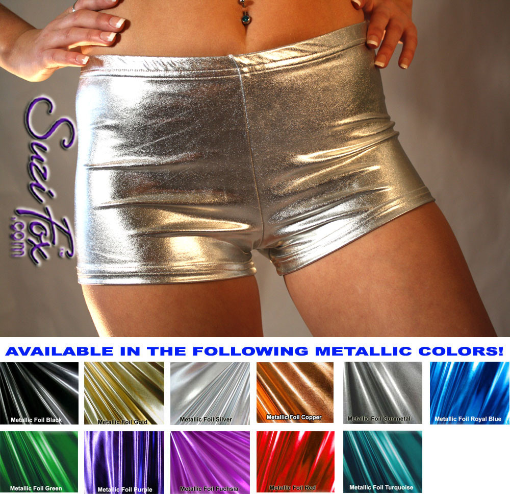 Womens Boy Shorts shown in Silver Metallic Foil coated Spandex, custom made by Suzi Fox. Custom made to your measurements! Available in gold, silver, copper, gunmetal, turquoise, Royal blue, red, green, purple, fuchsia, black faux leather/rubber, and any other fabric on this site. • 1 inch elastic at the waist. • 2 inch inseam is standard. • Optional 1 or 2-slider crotch zippers. • Optional rear patch pockets. • Optional Belt Loops. Made in the U.S.A.