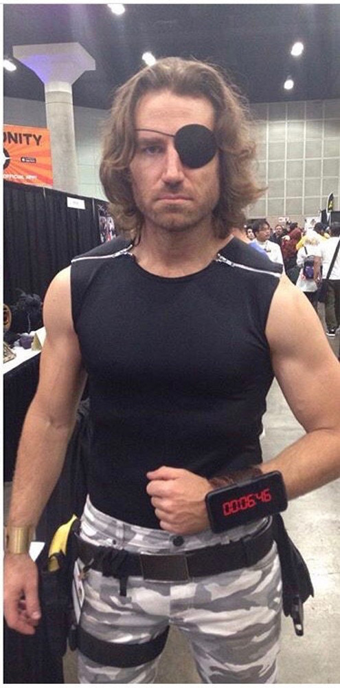 Snake Plissken style shirt as seen in the movie 'Escape From New York', custom made by Suzi Fox. Fabric shown is black wet look lycra spandex. • Available in black, white, red, turquoise, navy blue, royal blue, hot pink, lime green, green, yellow, steel gray, neon orange Wet Look. • 2 separating zippers at the shoulders. Aluminum is standard. • Free custom sizing! • Standard shirt length for XXS-Medium, from shoulder to hem, is 24 inches (61 cm), Large-6X is 27 inches (68.6 cm) Made in the U.S.A. CUSTOMER PICTURE! Thanks to Byrne Owens!