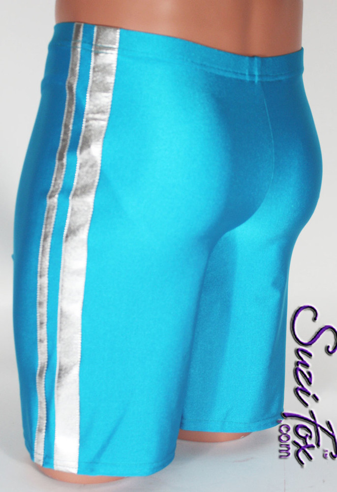 Mens Basketball or Board shorts shown in Turquoise Milliskin Tricot Spandex and Silver Metallic Stripe, custom made by Suzi Fox. • Available in black, white, red, royal blue, sky blue, turquoise, purple, green, neon green, hunter green, neon pink, neon orange, athletic gold, lemon yellow, steel gray Miilliskin Tricot spandex and any fabric on this site. • 1 inch no-roll elastic at the waist. • Optional belt loops. • Optional rear patch pockets. • Optional drawstring. • Made in the U.S.A.