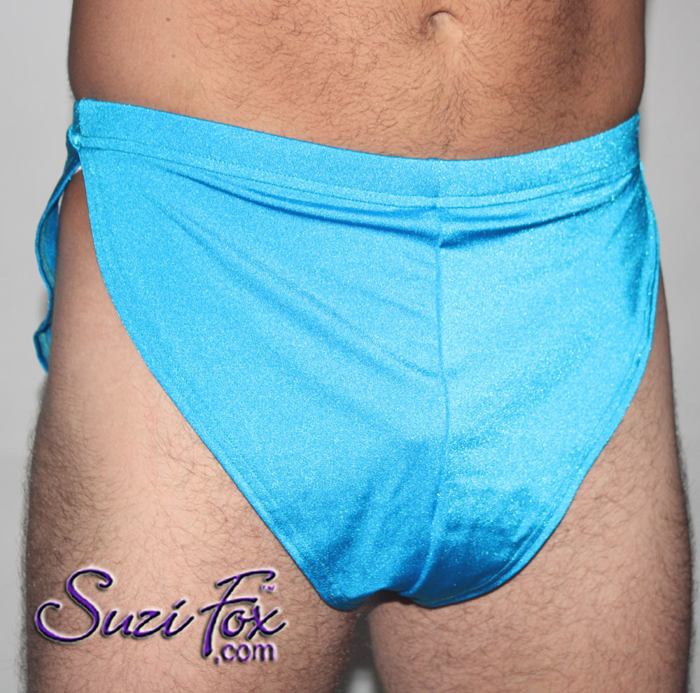 """Men's V front, Split Side Running/ Cover-Up Shorts shown in Turquoise Milliskin Tricot Spandex, custom made by Suzi Fox. • Available in black, white, red, royal blue, sky blue, turquoise, purple, green, neon green, hunter green, neon pink, neon orange, athletic gold, lemon yellow, steel gray Miilliskin Tricot spandex, and any fabric on this site. • 1 inch no-roll elastic at the waist. • Front inside pouch. • The A15's are a """"V"""" shape in the front, with less fabric on the front of the leg, and a very thin crotch. Commonly worn by runners and marathon participants, the A15's offer less chafing between the legs and does not inhibit the legs. • Made in the U.S.A."""