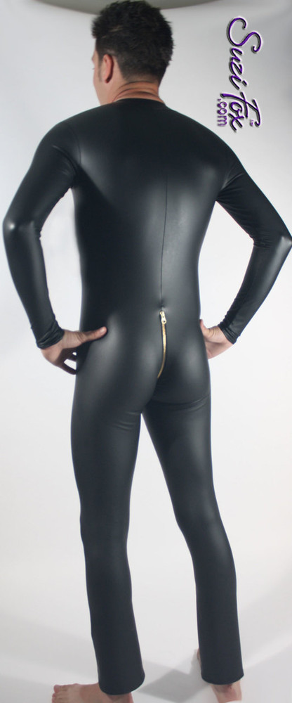 Mens custom Catsuit shown in Black matte (no shine) vinyl/PVC, with 2-slider crotch zipper, custom made by Suzi Fox. • Available in matte black (no shine), matte white (no shine), gloss black, white, red, navy blue, royal blue, turquoise, purple, Neon Pink, fuchsia, light pink, black 3D Prism, red 3D Prism, Turquoise 3D Prism, Baby Blue 3D Prism, and any fabric on this site. • Your choice of front or back zipper (front 2-slider crotch zipper shown). • Optional 1 or 2-slider crotch zipper. • Optional wrist zippers. • Optional ankle zippers. • Optional finger loops. • Made in the U.S.A.