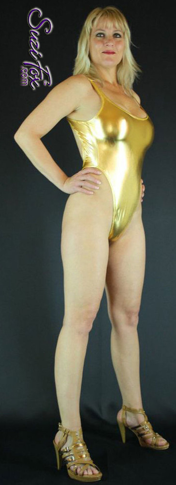 Womens One Piece T-back Thong Swim Suit shown in Gold Metallic foil Spandex, custom made by Suzi Fox. • Custom made to your measurements. • The high leg hole, low back and t-back thong rear create a stunning and sexy suit. • Available in gold, silver, copper, gunmetal, turquoise, Royal blue, red, green, purple, fuchsia, black faux leather/rubber Metallic Foil, and any fabric on this site. • Made in the U.S.A.