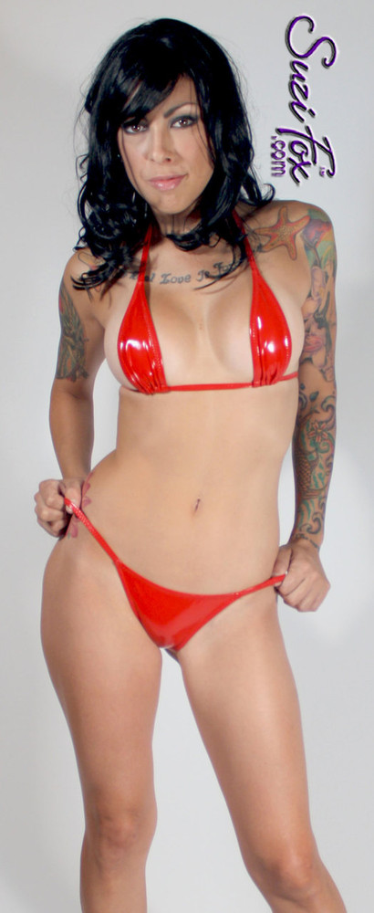 Womens skinny side Rio (1/2 rear coverage) Swim Suit bottom shown in Red Vinyl/PVC Spandex, custom made by Suzi Fox. • Custom made to your measurements. • Available in black, white, red, navy blue, royal blue, turquoise, purple, Neon Pink, fuchsia, light pink, matte black (no shine), matte white (no shine), black 3D Prism, red 3D Prism, Turquoise 3D Prism, Baby Blue 3D Prism, Hot Pink 3D Prism Vinyl/PVC, and any fabric on this site. • Top sold separately (shown with T36 teardrop bikini top). • Made in the U.S.A.