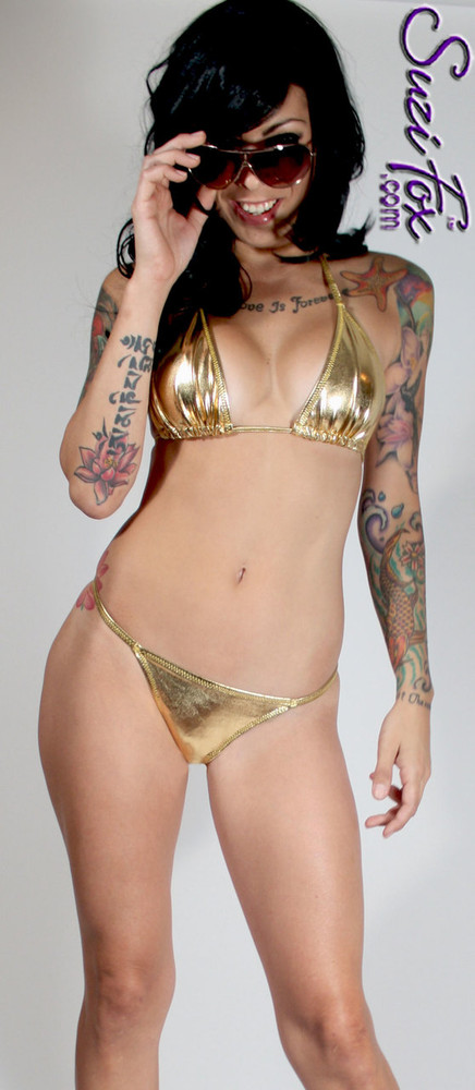 Womens skinny side Rio (1/2 rear coverage) Swim Suit bottom shown in Gold Metallic Foil Spandex, custom made by Suzi Fox. • Custom made to your measurements. • Available in gold, silver, copper, gunmetal, turquoise, Royal blue, red, green, purple, fuchsia, black faux leather/rubber Metallic Foil, and any fabric on this site. • Top sold separately. (T1 top shown) • Made in the U.S.A.