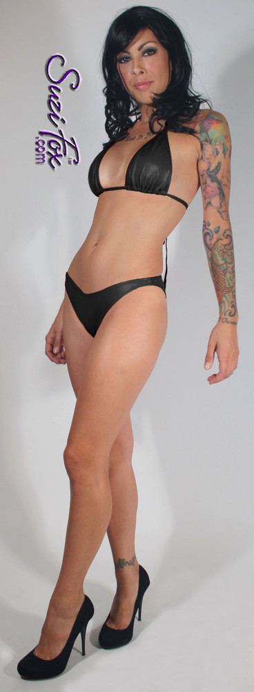 Womens Brazilian (3/4 rear coverage) Swim Suit bottom shown in Black Wet Look lycra Spandex, custom made by Suzi Fox. • Custom made to your measurements. • Available in black, white, red, turquoise, navy blue, royal blue, hot pink, lime green, green, yellow, steel gray, neon orange Wet Look, and any fabric on this site. • Top sold separately. (T1 top shown) • Made in the U.S.A.