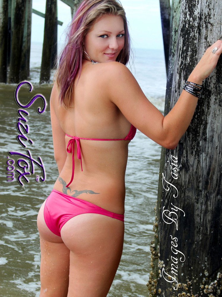 Womens Brazilian (3/4 rear coverage) Swim Suit bottom shown in Hot Pink Wet Look lycra Spandex, custom made by Suzi Fox. • Custom made to your measurements. • Available in black, white, red, turquoise, navy blue, royal blue, hot pink, lime green, green, yellow, steel gray, neon orange Wet Look, and any fabric on this site. • Top sold separately. (T1 top shown) • Made in the U.S.A. • Images by Tasia