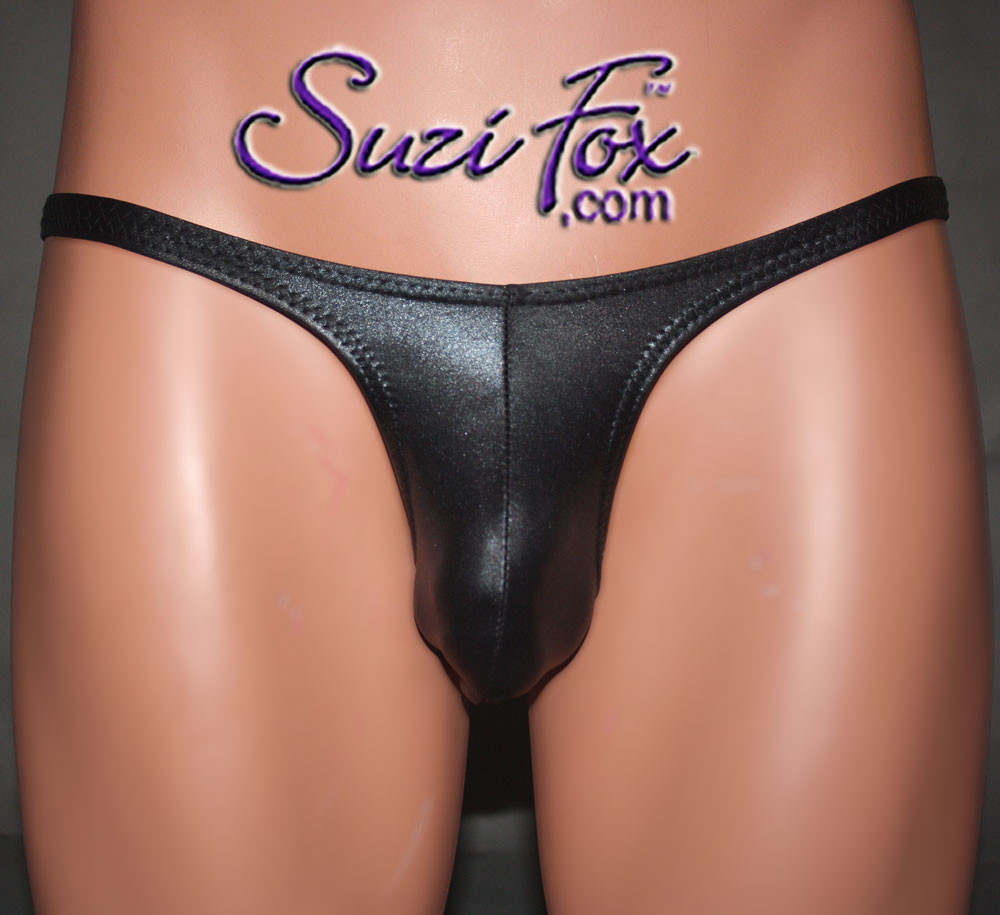 Mens Contoured Pouch Front, Wide Strap, T-Back thong - shown in Black Wetlook Lycra Spandex, custom made by Suzi Fox. • Available in black, white, red, turquoise, navy blue, royal blue, hot pink, lime green, green, yellow, steel gray, neon orange Wet Look or any fabric on this site. • Standard front height is 8 inches (20.3 cm). • Available in 4, 5, 6, 7, 8, 9, and 10 inch front heights. • Wear it as swimwear OR underwear! • Made in the U.S.A.