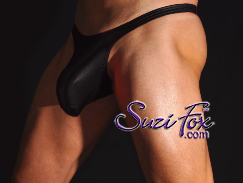 Well Endowed Mens Contoured Pouch Front, Wide Strap, T-Back thong - shown in Black Wetlook Lycra Spandex, custom made by Suzi Fox. • Available in black, white, red, turquoise, navy blue, royal blue, hot pink, lime green, green, yellow, steel gray, neon orange Wet Look or any fabric on this site. • Standard front height is 7 inches (17.8 cm). • Available in 4, 5, 6, 7, 8, 9, and 10 inch front heights. • Choose your pouch size! • Choose your rear style! • Wear it as swimwear OR underwear! • Made in the U.S.A.