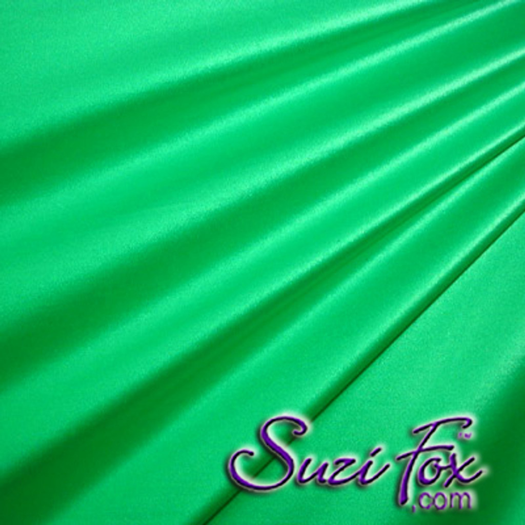 "Green Wet Look Lycra Spandex (Cire') Fabric.  85% Nylon. 15% Lycra. (per yard price if you want to buy extra is $25 per yard) This is a four way stretch fabric. Wet look lycra fabrics have undergone a heat treatment to give them a ""Cire'"" medium shine finish. Wet look lycra is a very stretchy fabric, it hugs the body but is extremely comfortable, and dries quickly. Available in black, white, red, turquoise, navy blue, royal blue, hot pink, lime green, green, yellow, steel gray, neon orange Wet Look.  Hand wash inside out in cold water, line dry. Iron inside out on low heat. Do not bleach."