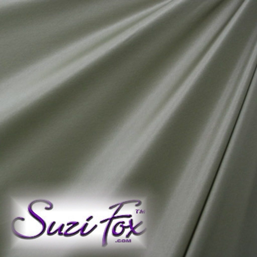 "Steel Gray Wet Look Lycra Spandex (Cire') Fabric.  85% Nylon. 15% Lycra. (per yard price if you want to buy extra is $25 per yard) This is a four way stretch fabric. Wet look lycra fabrics have undergone a heat treatment to give them a ""Cire'"" medium shine finish. Wet look lycra is a very stretchy fabric, it hugs the body but is extremely comfortable, and dries quickly. Available in black, white, red, turquoise, navy blue, royal blue, hot pink, lime green, green, yellow, steel gray, neon orange Wet Look.  Hand wash inside out in cold water, line dry. Iron inside out on low heat. Do not bleach."