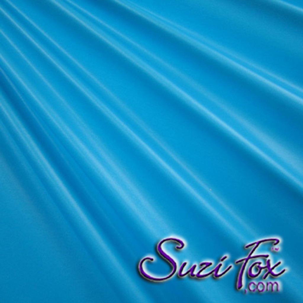"Turquoise Wet Look Lycra Spandex (Cire') Fabric.  85% Nylon. 15% Lycra. (per yard price if you want to buy extra is $25 per yard) This is a four way stretch fabric. Wet look lycra fabrics have undergone a heat treatment to give them a ""Cire'"" medium shine finish. Wet look lycra is a very stretchy fabric, it hugs the body but is extremely comfortable, and dries quickly. Available in black, white, red, turquoise, navy blue, royal blue, hot pink, lime green, green, yellow, steel gray, neon orange Wet Look.  Hand wash inside out in cold water, line dry. Iron inside out on low heat. Do not bleach."