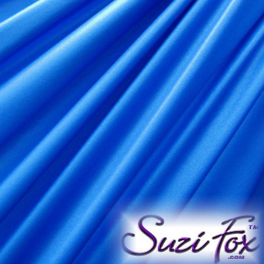 "Royal Blue Wet Look Lycra Spandex (Cire') Fabric.  85% Nylon. 15% Lycra. (per yard price if you want to buy extra is $25 per yard) This is a four way stretch fabric. Wet look lycra fabrics have undergone a heat treatment to give them a ""Cire'"" medium shine finish. Wet look lycra is a very stretchy fabric, it hugs the body but is extremely comfortable, and dries quickly. Available in black, white, red, turquoise, navy blue, royal blue, hot pink, lime green, green, yellow, steel gray, neon orange Wet Look.  Hand wash inside out in cold water, line dry. Iron inside out on low heat. Do not bleach."