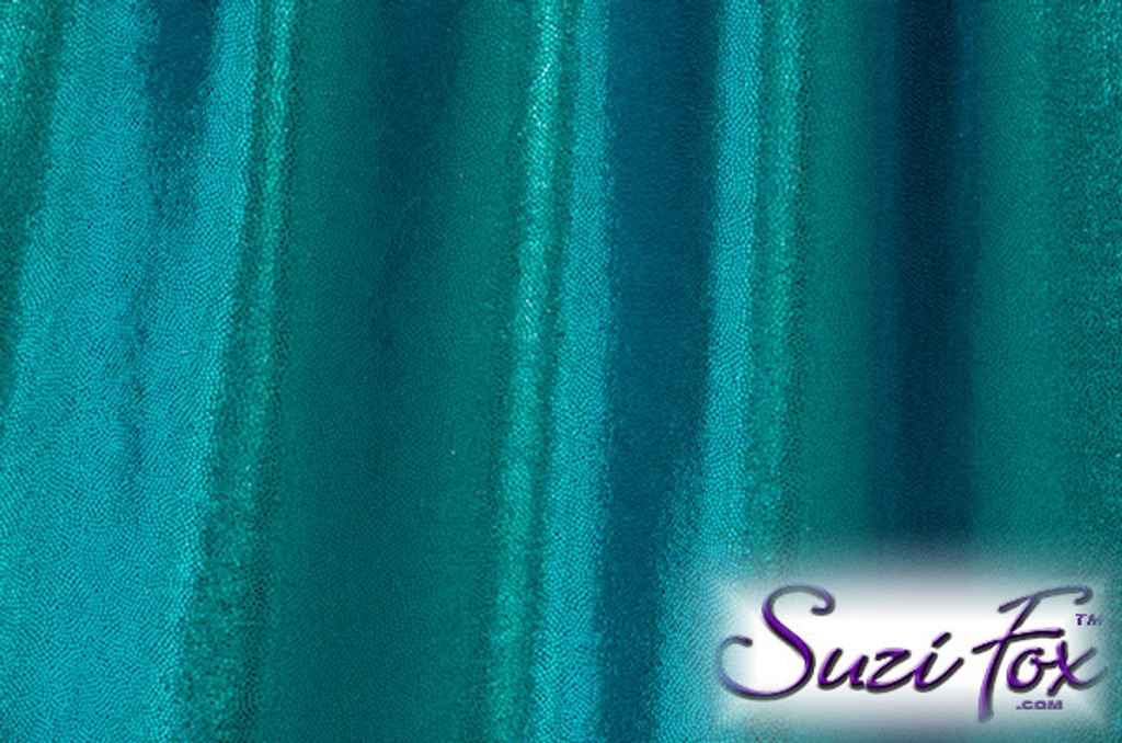 Turquoise Metallic Mystique Fabric. (per yard price if you want to buy extra is $25 per yard) 80% Nylon, 20% Spandex. Available in black, red, turquoise, green, purple, royal blue, hot pink/fuchsia, baby pink, baby blue, silver, copper, gold Metallic Mystique spandex. This is a 4-way stretch fabric with tiny metallic foil dots bonded to the spandex. Light, thin, airy, very comfortable! Glitters in the light!  Metallic will rub off if rubbed excessively. Hand wash inside out in cold water, line dry. Iron inside out on low heat. Do not bleach.