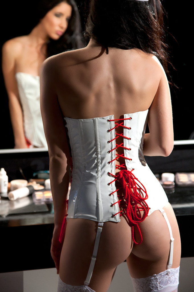Allure Leather Vinyl 3-Piece Set Nurse Corset. This vinyl nurse corset set is playfully naughty. The white corset is fitted to perfection with boning and a lace-up back. Racy red lacing on the sides and back are incredibly seductive, and the matching cap and g-string complete this sexy fantasy. It also comes with detachable garters.