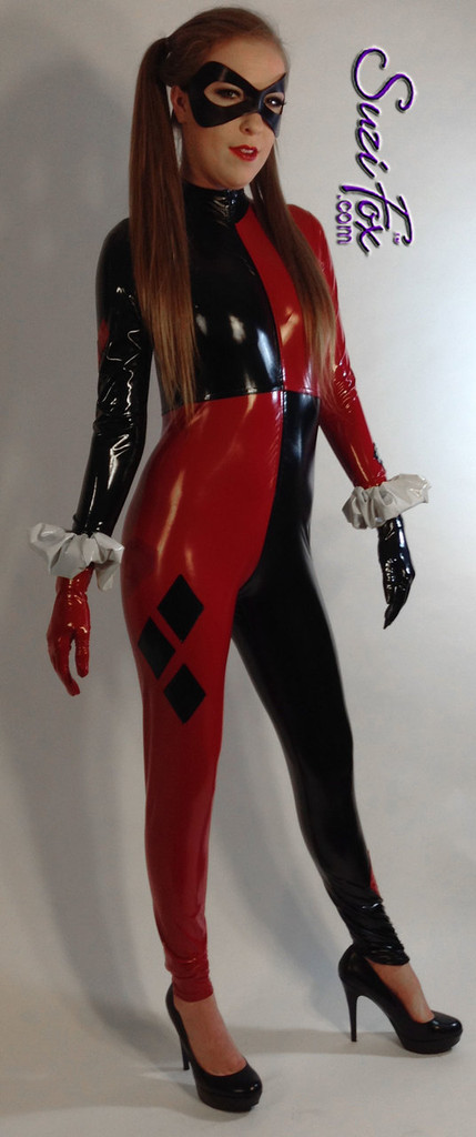Custom Harley Quinn Catsuit by Suzi Fox in Stretch Gloss Red and Black Vinyl coated Nylon Spandex. Includes catsuit, gloves, wrist ruffles. Mask not included. Popular fabrics are: red & black vinyl/PVC, red & black metallic foil, red & black wet look lycra Spandex. • Optional 1 or 2-slider crotch zipper. • Optional wrist zippers • Optional ankle zippers • Made in the U.S.A.