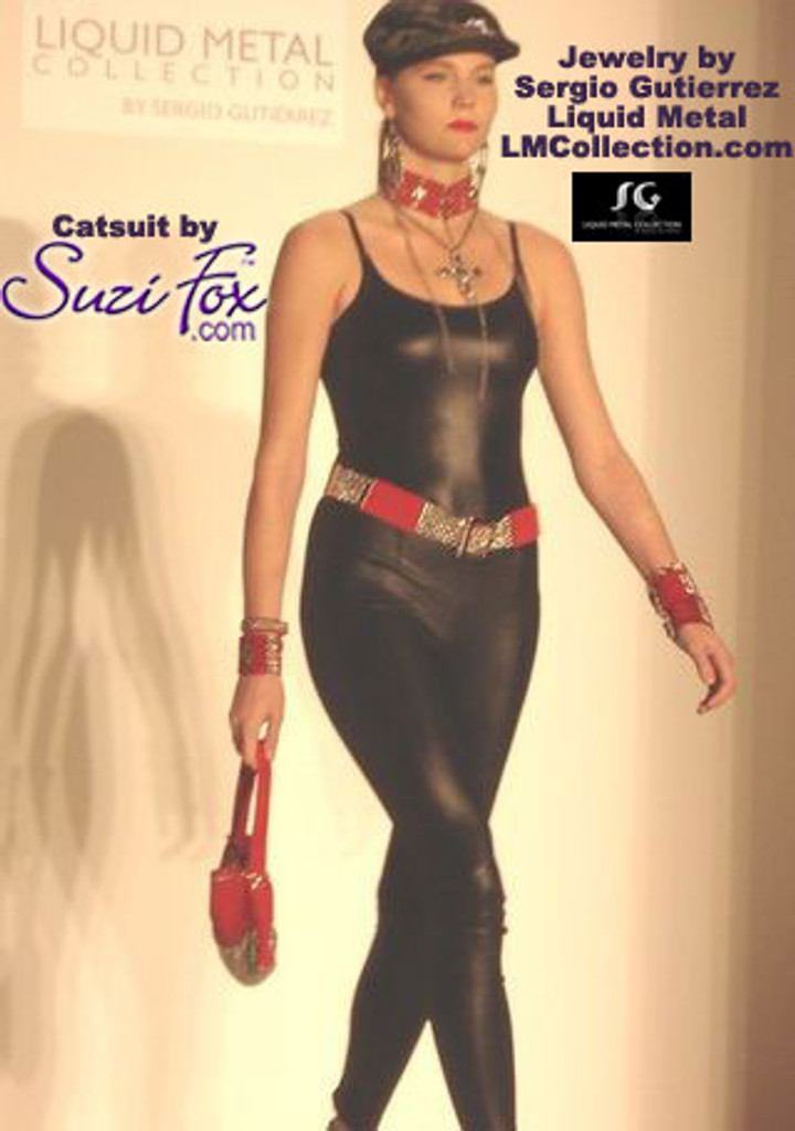 Womens Camisole Catsuit shown in Black Wetlook Lycra Spandex, custom made by Suzi Fox. Custom made to your measurements! • Spaghetti straps. • Available in black, white, red, turquoise, navy blue, royal blue, hot pink, lime green, green, yellow, steel gray, neon orange Wet Look, and any fabric on this site. • Optional ankle zippers. • Made in the U.S.A. This model was wearing a Suzi Fox Camisole Style Catsuit in the Fashion and Jewelry show for Sergio Gutierrez's Liquid Metal Spring/Summer 2010 Collection in LA in September, 2009.