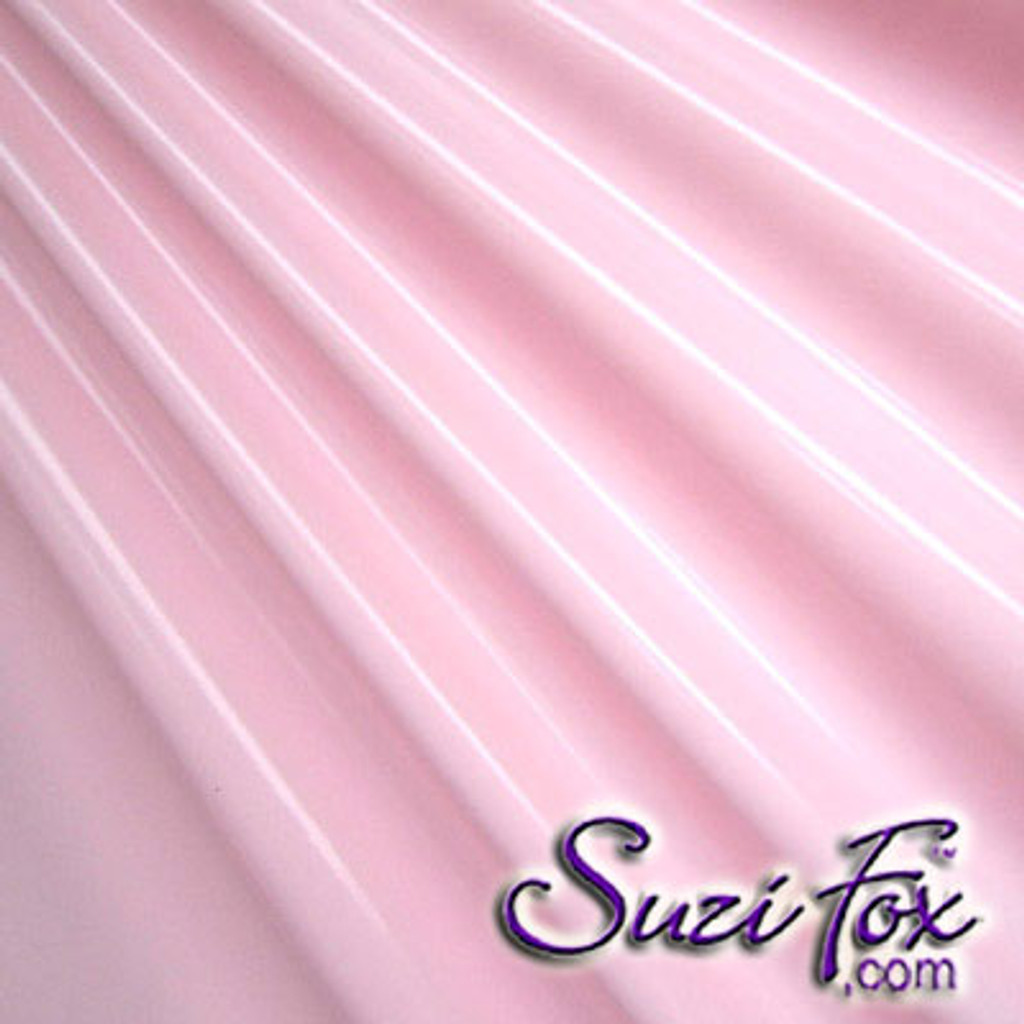 """Light Pink Gloss Vinyl/PVC.  Four Way Stretch. 80% Nylon, 20% Spandex.  Polyurethane coated. Very glossy! This fabric is very tight, 4-way stretch with about a 2"""" stretch. It will hide minor cellulite and hold in small love handles. Vinyl will separate from backing if worn too tight or if rubbed excessively. If you like PVC, you will LOVE this fabric! It's also a great alternative to latex.   Available in black, white, red, navy blue, royal blue, turquoise, purple, Neon Pink, fuchsia, light pink, matte black (no shine), matte white (no shine), black 3D Prism, red 3D Prism, Turquoise 3D Prism, Baby Blue 3D Prism, Hot Pink 3D Prism.  Hand wash inside out in cold water, line dry. Iron inside out on low heat. Do not bleach."""