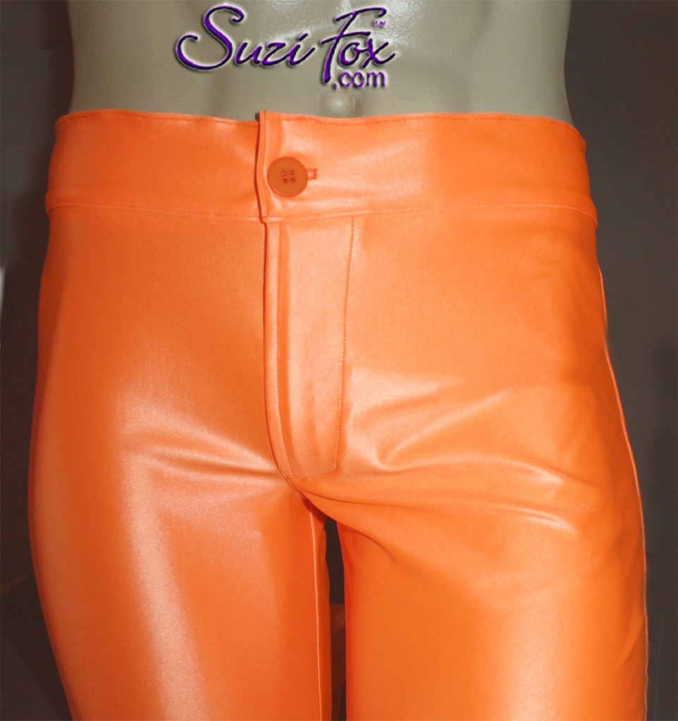 Mens Jean style Pants shown in Neon Orange Wetlook Lycra Spandex, custom made by Suzi Fox. Custom made to your measurements! • Available in black, white, red, turquoise, navy blue, royal blue, hot pink, lime green, green, yellow, steel gray, neon orange Wet Look and any fabric on this site. • Fly front zipper and waistband. • Choose your ankle size - tight ankles, jean cut, boot cut, or bellbottom. • Optional ankle zippers. • Optional belt loops. • Optional rear patch pockets. Made in the U.S.A.