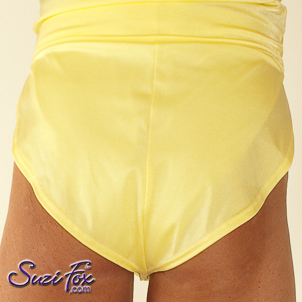 "Men's V front, Split Side Running/ Cover-Up Shorts shown in Yellow Milliskin Tricot Spandex, custom made by Suzi Fox. • Available in black, white, red, royal blue, sky blue, turquoise, purple, green, neon green, hunter green, neon pink, neon orange, athletic gold, lemon yellow, steel gray Miilliskin Tricot spandex, and any fabric on this site. • 1 inch no-roll elastic at the waist. • Front inside pouch. • The A15's are a ""V"" shape in the front, with less fabric on the front of the leg, and a very thin crotch. Commonly worn by runners and marathon participants, the A15's offer less chafing between the legs and does not inhibit the legs. • Made in the U.S.A."