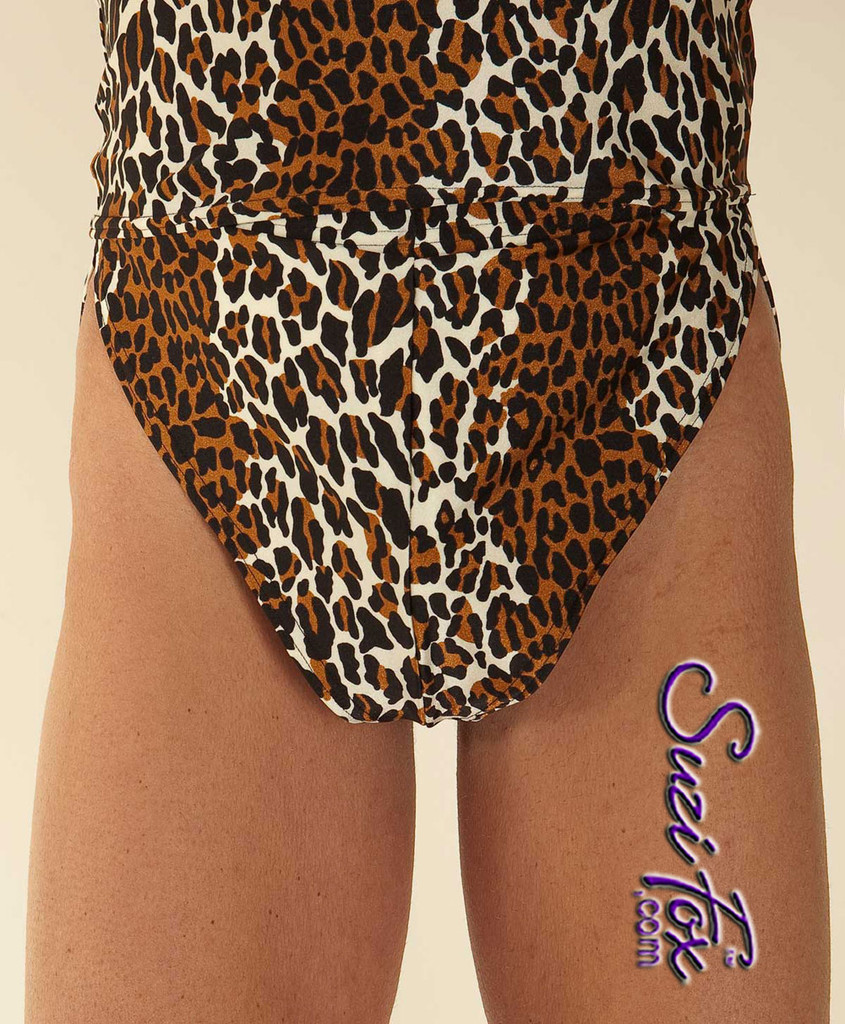 """Men's V front, Split Side Running/ Cover-Up Shorts shown in Leopard Print Spandex, custom made by Suzi Fox. • Available in any fabric on this site. • 1 inch no-roll elastic at the waist. • Front inside pouch. • The A15's are a """"V"""" shape in the front, with less fabric on the front of the leg, and a very thin crotch. Commonly worn by runners and marathon participants, the A15's offer less chafing between the legs and does not inhibit the legs. • Made in the U.S.A."""