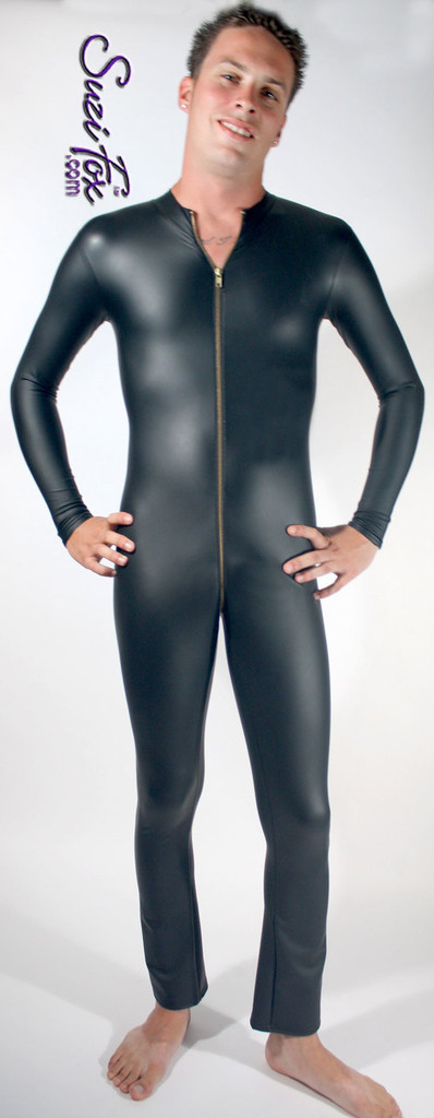 Mens Catsuit shown in Black matte (no shine) vinyl/PVC, with 2-slider crotch zipper, custom made by Suzi Fox. • Available in matte black (no shine), matte white (no shine), gloss black, white, red, navy blue, royal blue, turquoise, purple, Neon Pink, fuchsia, light pink, black 3D Prism, red 3D Prism, Turquoise 3D Prism, Baby Blue 3D Prism, Hot Pink 3D Prism, and any fabric on this site. • Your choice of front or back zipper (front 2-slider crotch zipper shown). • Optional 1 or 2-slider crotch zipper. • Optional wrist zippers. • Optional ankle zippers. • Optional finger loops. • Made in the U.S.A.