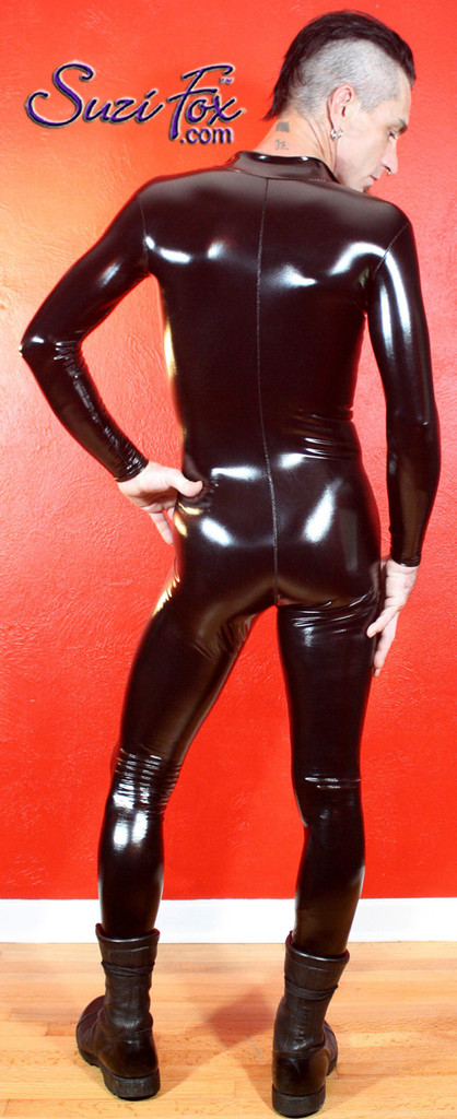 Mens Catsuit by Suzi Fox shown in Black Gloss Vinyl/PVC coated Nylon Spandex, custom made by Suzi Fox. (shown without crotch zipper) • Available in black, white, red, navy blue, royal blue, turquoise, purple, Neon Pink, fuchsia, light pink, matte black (no shine), matte white (no shine), black 3D Prism, red 3D Prism, Turquoise 3D Prism, Baby Blue 3D Prism, Hot Pink 3D Prism, and any fabric on this site. • Your choice of front or back zipper (front zipper shown). • Optional 1 or 2-slider crotch zipper. • Optional wrist zippers • Optional ankle zippers • Optional finger loops • Made in the U.S.A.