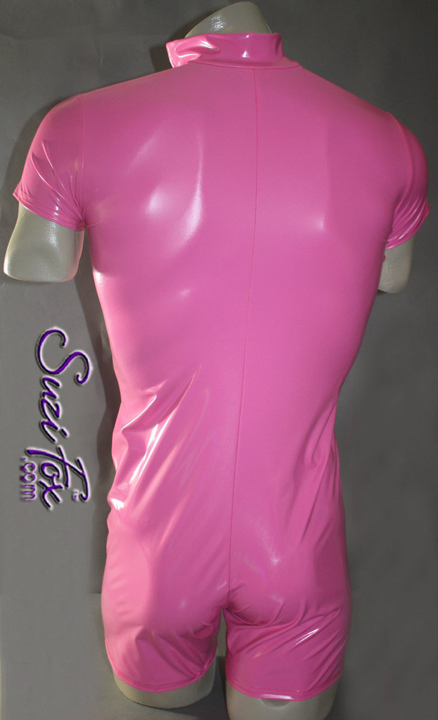 Mens Romper shown in Neon Pink Vinyl/PVC Spandex, custom made by Suzi Fox. • Available in black, white, red, navy blue, royal blue, turquoise, purple, Neon Pink, fuchsia, light pink, matte black (no shine), matte white (no shine), black 3D Prism, red 3D Prism, Turquoise 3D Prism, Baby Blue 3D Prism, Hot Pink 3D Prism, and any fabric on this site. • Your choice of front or back zipper (front zipper shown). • Optional 1 or 2-slider crotch zipper. • Optional long sleeves. • Optional wrist zippers • Optional finger loops • 4 inch inseam and 6 inch sleeve shown. • Made in the U.S.A.