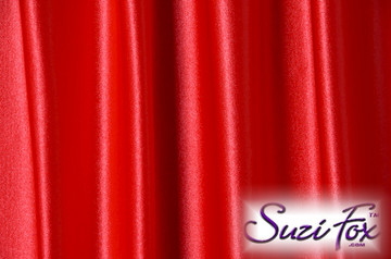 """Red Wet Look Lycra Spandex (Cire') Fabric.  85% Nylon. 15% Lycra. (per yard price if you want to buy extra is $25 per yard) This is a four way stretch fabric. Wet look lycra fabrics have undergone a heat treatment to give them a """"Cire'"""" medium shine finish. Wet look lycra is a very stretchy fabric, it hugs the body but is extremely comfortable, and dries quickly. Available in black, white, red, turquoise, navy blue, royal blue, hot pink, lime green, green, yellow, steel gray, neon orange Wet Look.  Hand wash inside out in cold water, line dry. Iron inside out on low heat. Do not bleach."""