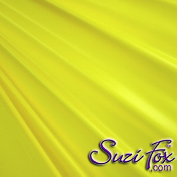 "Yellow Wet Look Lycra Spandex (Cire') Fabric.  85% Nylon. 15% Lycra. (per yard price if you want to buy extra is $25 per yard) This is a four way stretch fabric. Wet look lycra fabrics have undergone a heat treatment to give them a ""Cire'"" medium shine finish. Wet look lycra is a very stretchy fabric, it hugs the body but is extremely comfortable, and dries quickly. Available in black, white, red, turquoise, navy blue, royal blue, hot pink, lime green, green, yellow, steel gray, neon orange Wet Look.  Hand wash inside out in cold water, line dry. Iron inside out on low heat. Do not bleach."