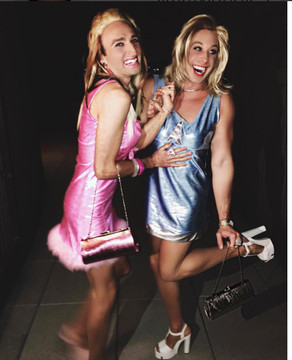 """OK, kind of silly, but these are two GUYS wearing Suzi Fox's Romy and Michele dresses for Halloween. We think they are adorable <3  Custom pink dress from the movie """"Romy & Michele's High School Reunion"""" by Suzi Fox.  • Custom made to your measurements! • Bow at the bodice • fur/feather hemline • flared skirt  We recommend our baby pink metallic mystique fabric.  played by Lisa Kudrow (Romy)  See our version of Michele's dress here: http://www.LiquidVinylClothing.com/D11B-3321"""