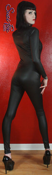 """Custom Catsuit by Suzi Fox shown in Matte Black (no shine) Vinyl/PVC coated Nylon Spandex.  Perfect for DKR Catwoman Costume. You can order this Catsuit in almost any fabric on this site.  • Available in black matte (no shine), white matte (no shine), and gloss black, red, white, light pink, neon pink, fuchsia, purple, royal blue, navy blue, turquoise, stretch vinyl coated spandex. • Your choice of front or back zipper (front zipper shown). • Optional 1 or 2-slider crotch zipper, and """"Selene"""" from Underworld TS zipper, or aluminum circular slider zipper like Catwoman comic characters. • Optional wrist zippers • Optional ankle zippers • Optional finger loops • Optional rear patch pockets • Made in the U.S.A."""