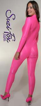 """Custom Catsuit by Suzi Fox shown in Hot Pink Wet Look Lycra Spandex.  You can order this Catsuit in almost any fabric on this site.  • Available in black, red, white, turquoise, navy blue, hot pink, lime green, green, yellow, royal blue, steel gray, neon orange. This is a 4-way stretch fabric with a medium shine. • Your choice of front or back zipper (front zipper shown). • Optional 1 or 2-slider crotch zipper, and """"Selene"""" from Underworld TS Brass zipper, or aluminum circular slider zipper like Catwoman comic characters. • Optional wrist zippers • Optional ankle zippers • Optional finger loops • Optional rear patch pockets • Made in the U.S.A."""