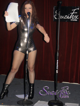 "Customer Photo!  Custom Romper Catsuit by Suzi Fox shown in Gun Metal metallic foil coated Nylon Spandex.  You can order this Romper in almost any fabric on this site.  • Available in gold, silver, copper, royal blue, purple, turquoise, red, green, fuchsia, gun metal, black faux leather/rubber Metallic foil coated spandex. • Standard sleeve length: 6 inches (15.2 cm) • Standard inseam: 2 inches (5.1 cm) • Your choice of front or back zipper (front zipper shown). • Optional 1 or 2-slider crotch zipper, and ""Selene"" from Underworld TS Brass zipper, or aluminum circular slider zipper like Catwoman comic characters. • Optional wrist zippers. • Optional rear patch pockets. • Made in the U.S.A."